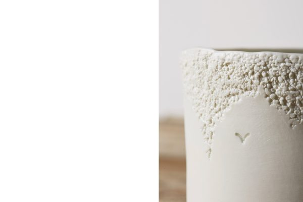 detail of a white porcelain vase with texture and logo - handmade - Federica Ramacciotti
