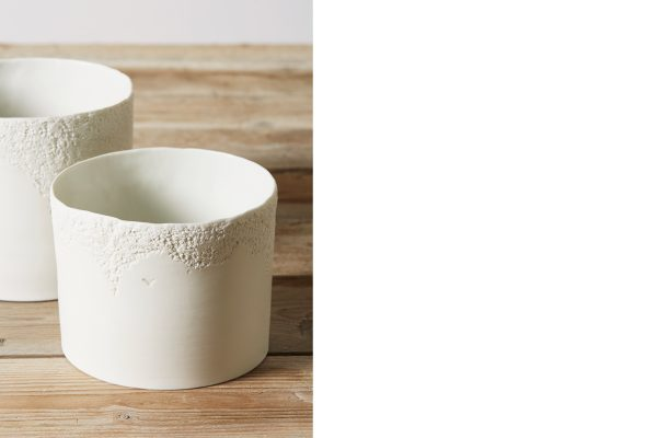 detail of two white porcelain vase with texture on a wooden table - handmade - Federica Ramacciotti