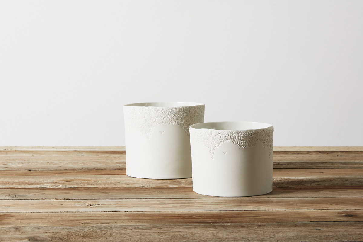 two white porcelain vases with texture on a wooden table - handmade - Federica Ramacciotti