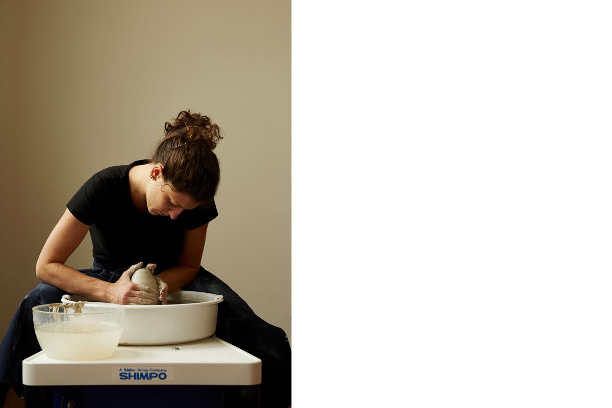 a woman potter working clay on a ceramic wheel - Federica Ramacciotti
