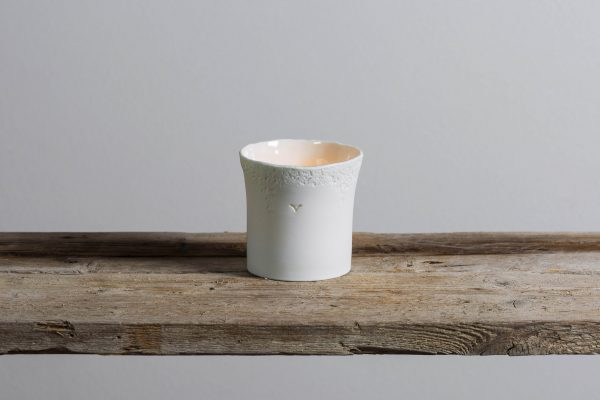 a white textured porcelain candle holder on a shelf - handmade - Federica Ramacciotti