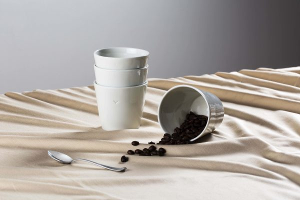 three white porcelain cups stacked with some coffee beans - handmade - Federica Ramacciotti