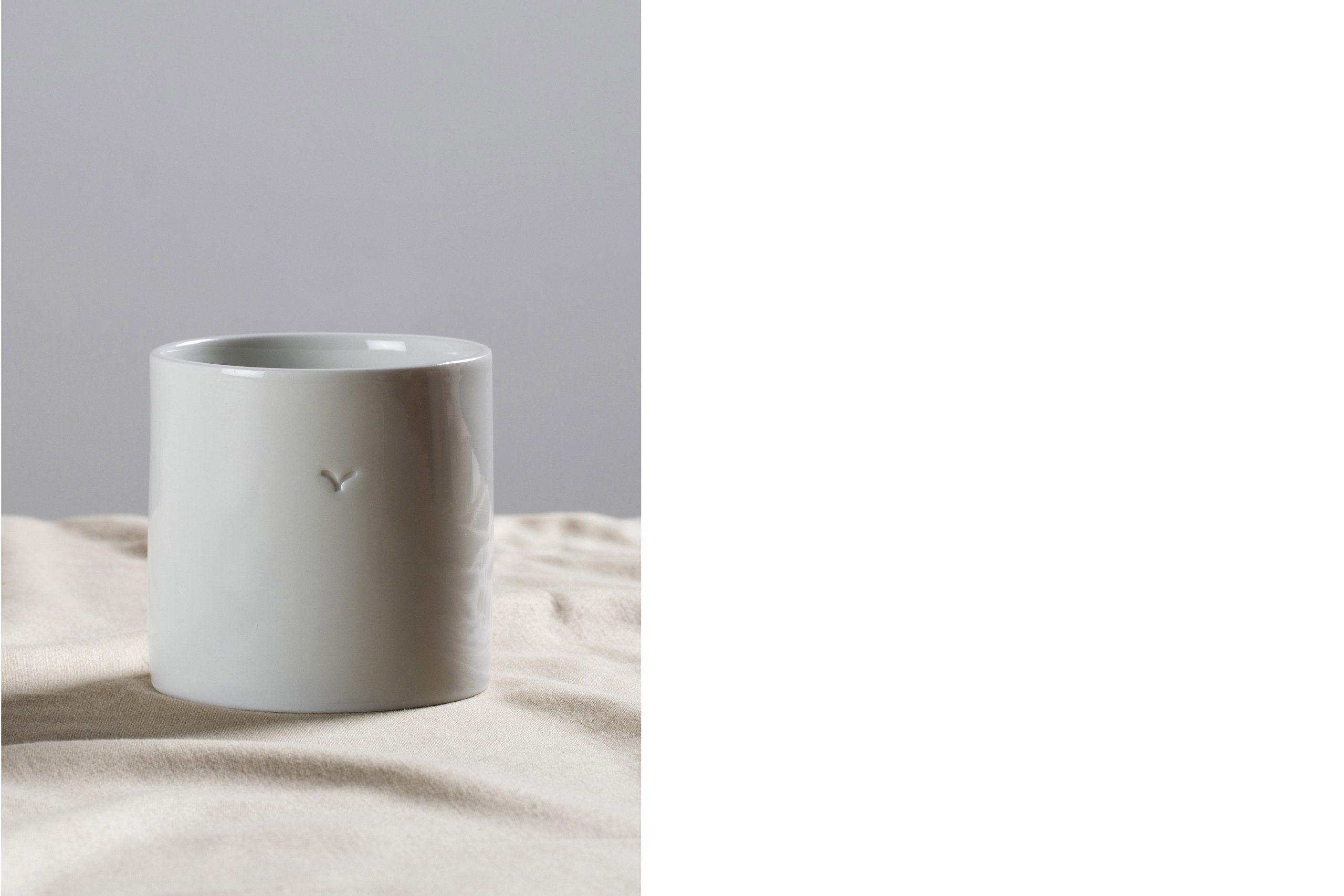 a handmade cylindrical white porcelain cup - Federica Ramacciotti