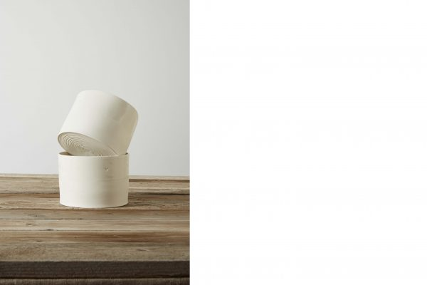 two stacked white porcelain vases on a wooden table - handmade - Federica Ramacciotti