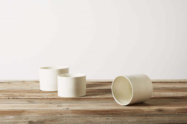three white porcelain vases on a wooden table - handmade - Federica Ramacciotti