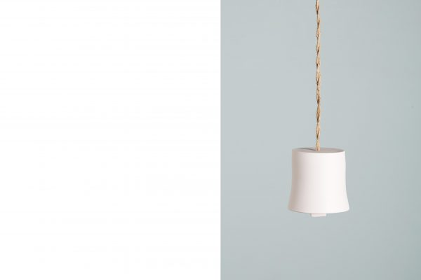 a white porcelain bell suspended with a coiled rope - handmade - Federica Ramacciotti