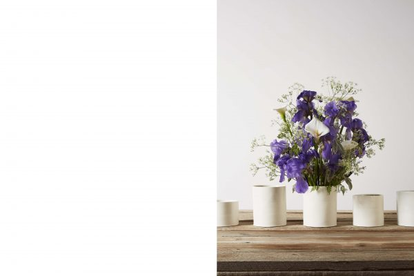 ve white porcelain vases on a wooden table with some flowers - handmade - Federica Ramacciotti