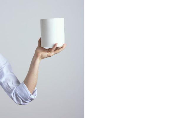 a white ceramic vase held in the hand of the craftsman - handmade - Federica Ramacciotti