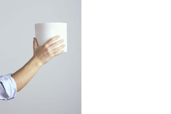 a white textured ceramic vase held in the hands of the craftsman - handmade - Federica Ramacciotti